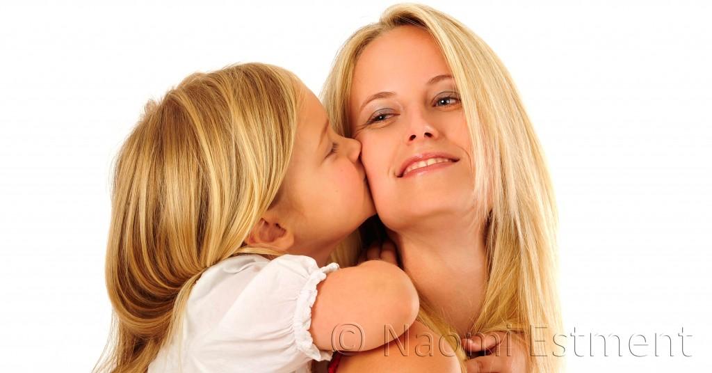 Daughter kissing Mom
